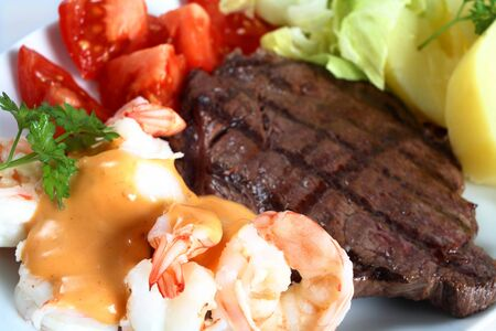A surf and turf meal of steak and prawns