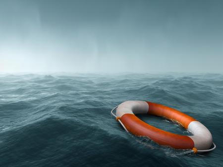 Foto de Lifebuoy floating in the vast expanse of sea - Imagen libre de derechos