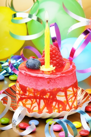 Colorful birthday cake with candle and festive decoration