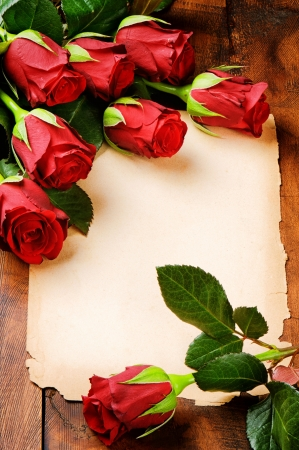 Photo for Romantic frame with red roses and vintage paper - Royalty Free Image