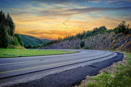 Photo pour Landscape with curvy road at summer sunset - image libre de droit