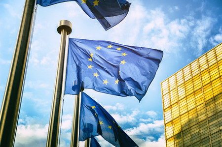 Photo for Waving EU flags in front of European Commission in Brussels - Royalty Free Image