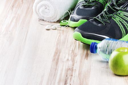 Foto de Pair of sport shoes and fitness accessories with copyspace - Imagen libre de derechos