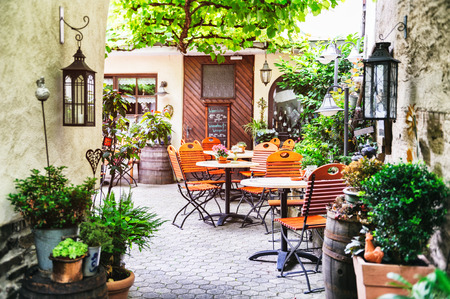 Photo for Cafe terrace in small European city - Royalty Free Image