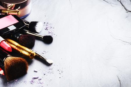 Photo pour Various makeup products on stone background - image libre de droit
