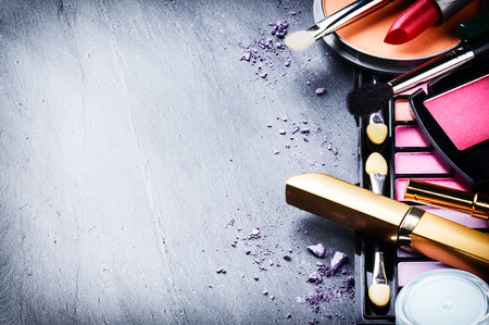 Photo pour Various makeup products on dark background with copyspace - image libre de droit