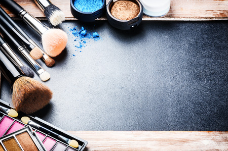 Foto de Various makeup products on dark background with copyspace - Imagen libre de derechos