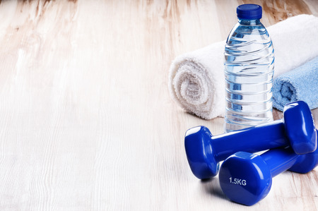 Photo for Fitness concept with dumbbells and water bottle. Workout setting - Royalty Free Image