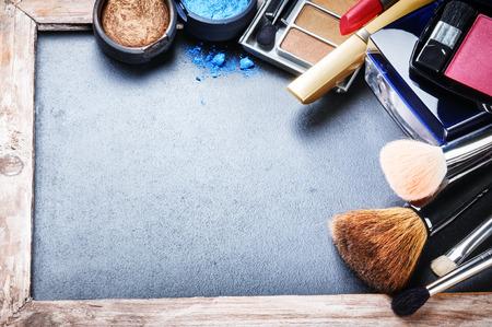 Photo pour Various makeup products on dark background with copyspace - image libre de droit