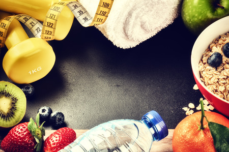 Photo for Fitness frame with dumbbells, water bottle and fresh fruits. Healthy lifestyle concept with copy space - Royalty Free Image