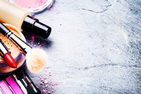 Various makeup products in pink tone with copyspace