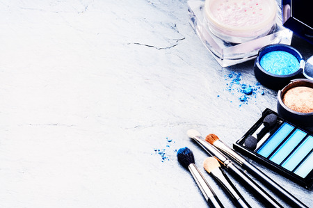 Photo for Various makeup products in blue tone with copyspace - Royalty Free Image