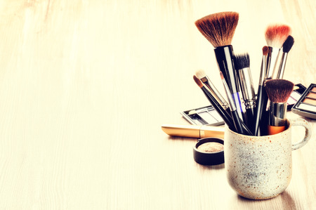 Foto de Various makeup brushes on light background with copyspace - Imagen libre de derechos