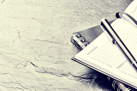 Photo pour Business concept with paper agenda and pen. Copy space - image libre de droit