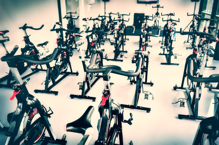 Foto per Healthy lifestyle concept. Spinning class with empty bikes - Immagine Royalty Free