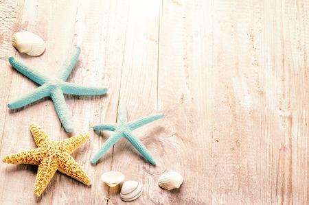 Foto de Summer setting with sea shells on old wooden background - Imagen libre de derechos