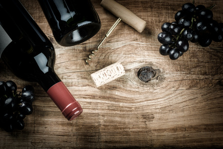 Photo pour Setting with bottle of red wine, grape and corks. Wine list concept with copy space - image libre de droit