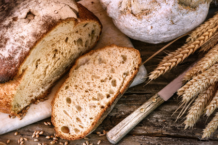 Photo for Freshly baked bread in rustic setting. Food background - Royalty Free Image