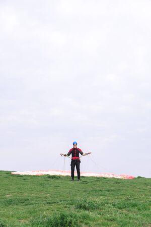 Foto de Man landed and takes off parachute from his body - Imagen libre de derechos