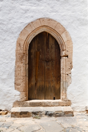 Ancient wooden arched door w mural
