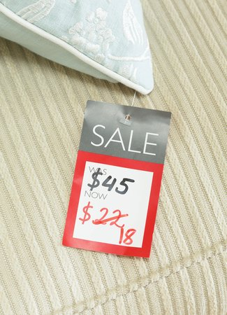 Foto de Mock-up of price tag showing reduced price of a discounted product on sale in a retail store. Priced in dollars for US market - Imagen libre de derechos