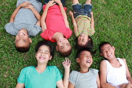 Photo pour 6 children having good time in the park. - image libre de droit