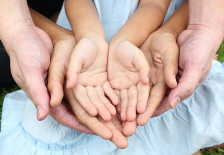 Photo pour Adult hands holding kid hands - image libre de droit