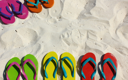 Photo for Summer vacation concept--Flipflops on a sandy ocean beach - Royalty Free Image