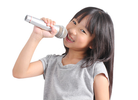 Photo for Pretty little girl with the microphone in her hand - Royalty Free Image
