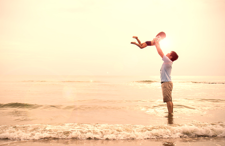 Photo pour Asian father and little girl playing on the beach at the sunset, Dad holding daughter flying at the beach. Together love family concept. Father's day - image libre de droit