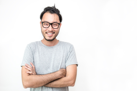 Photo pour Attractive beautiful smiling positive nerd man - close up portrait asian beard nerdy man with crossed arms isolated on white background. - image libre de droit