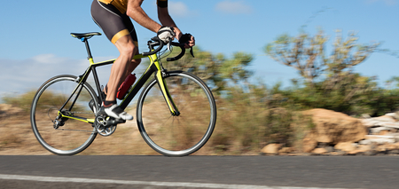 Foto per Motion blur of a bike race with the bicycle and rider at high speed - Immagine Royalty Free