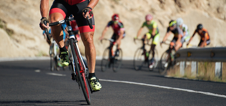 Foto de Cycling competition,cyclist athletes riding a race at high speed - Imagen libre de derechos