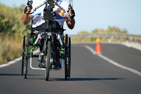 Photo for Single wheelchair athlete in action during a marathon - Royalty Free Image