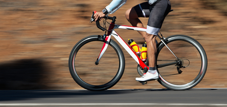 Photo pour Motion blur of a bike race with the bicycle and rider at high speed - image libre de droit