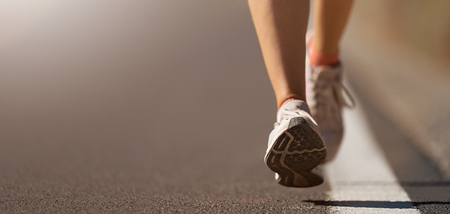 Foto per Running shoe closeup of woman running on road with sports shoes - Immagine Royalty Free