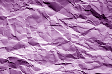 Foto de Crumpled sheet of paper in purple tone. Abstract background and texture for design. - Imagen libre de derechos
