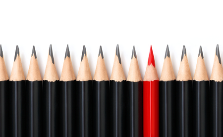 Photo for Red pencil standing out from crowd of plenty identical black pencils on white background. Leadership, uniqueness, independence, initiative, strategy, dissent, think different, business success concept - Royalty Free Image