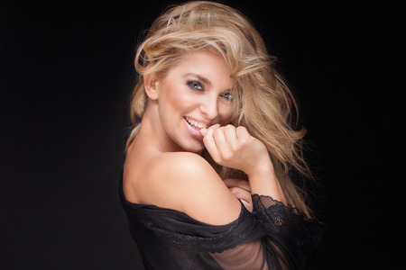 Photo pour Beauty portrait of attractive delicate blonde woman. Studio shot. Girl with long curly hair and perfect makeup. - image libre de droit