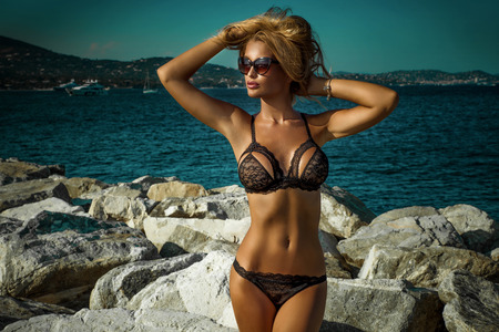 Photo pour Summer photo of beautiful sexy blonde woman in elegant lace lingerie. Sunny day. Luxury resort. Girl with perfect slim body. - image libre de droit
