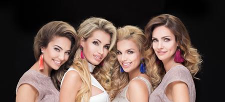 Photo pour Portrait of four beautiful adult ladies. Glamour makeup. Elegant look. - image libre de droit