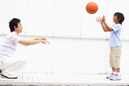 Photo for Father and son to have a basketball - Royalty Free Image