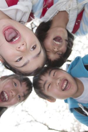 Four elementary school smile