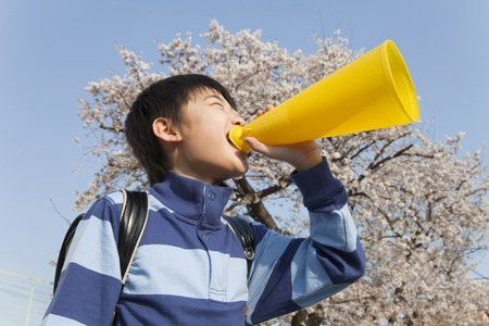Elementary school boys screaming with a megaphone