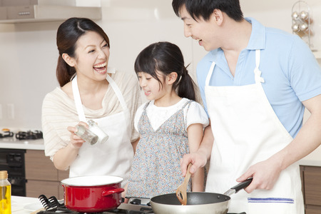 Photo for Parent and child cooking - Royalty Free Image