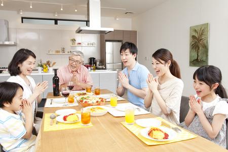 Photo pour Surrounding the table three generation family - image libre de droit