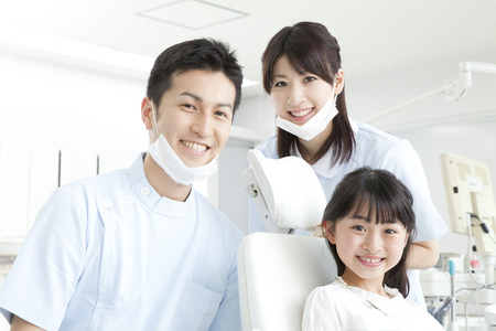 Photo for Smile dentist and girls - Royalty Free Image
