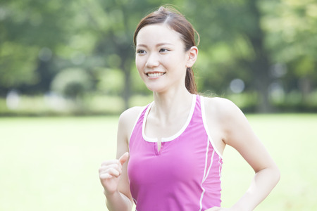 Photo for Woman jogging - Royalty Free Image