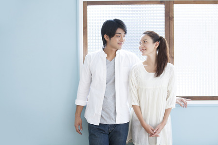 Photo pour Couples each other staring at the windowsill - image libre de droit