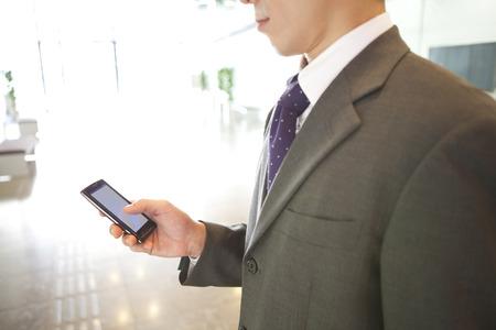 Photo pour Businessman with a Smartphone - image libre de droit